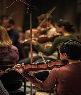 Image of people playing violin